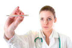 Attractive female doctor with thermometer Stock Photo