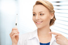 Attractive female doctor with thermometer Stock Photography