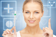 Attractive female doctor with thermometer. Picture of attractive female doctor with thermometer Stock Photography