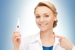 Attractive female doctor with thermometer Royalty Free Stock Photo