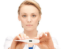 Attractive female doctor with thermometer. Picture of attractive female doctor with thermometer Stock Photo