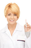 Attractive female doctor with thermometer Stock Photos