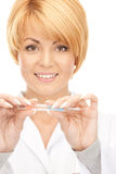 Attractive female doctor with thermometer. Picture of attractive female doctor with thermometer Stock Photos