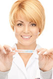 Attractive female doctor with thermometer. Picture of attractive female doctor with thermometer Royalty Free Stock Photo