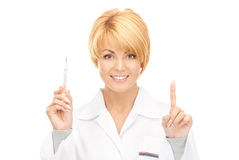 Attractive female doctor with thermometer. Picture of attractive female doctor with thermometer Royalty Free Stock Image