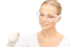Attractive female doctor with thermometer Stock Images