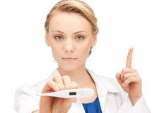 Attractive female doctor with thermometer. Picture of female doctor with thermometer showing finger up Royalty Free Stock Photo