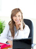 Attractive female doctor working with a laptop Stock Photo