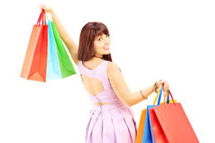Attractive female in dress holding shopping bags Stock Photos