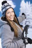 Attractive female dressed for skiing smiling Stock Images