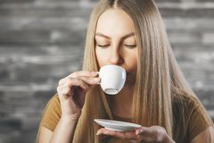 Attractive female drinking coffee Royalty Free Stock Photo