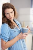 Attractive female drinking tea at home Stock Photos