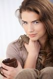 Attractive female drinking tea smiling Stock Photo