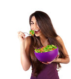 Attractive female eat salad Royalty Free Stock Photography