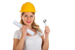 Attractive female engineer with house-project in her hands. Picture of an attractive female engineer holding a toggle and a project Stock Photo