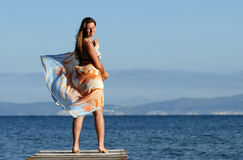 Attractive female enjoying at beach. Attractive female enjoying at beautiful exotic beach, Thassos, Greece Royalty Free Stock Photos