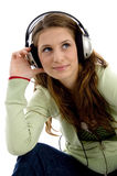 Attractive female enjoying music track. On an isolated white background Stock Images