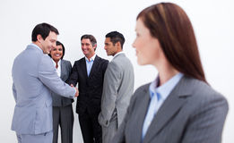 Attractive female executive looking at her team Stock Photography