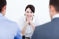 Attractive female executive at a meeting Royalty Free Stock Image
