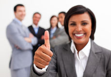 Attractive female executive smiling at the camera Stock Photos