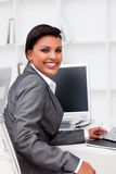 Attractive female executive working at a compute. Attractive female executive  working at a computer in the office Royalty Free Stock Photography
