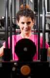 Attractive female face thru gym equipment Stock Images