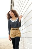 Attractive female fashion model smiling and walking outdoors Stock Images