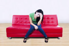 Attractive female feels depressed at home Stock Images