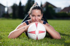 Attractive female with a football Stock Photos