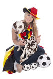 Attractive female german soccer fan with dalmatian dog Stock Photo