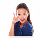 Attractive female gesturing a phone call Royalty Free Stock Image