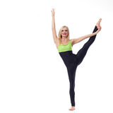 Attractive female gymnast exercising at studio Royalty Free Stock Photos