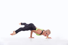 Attractive female gymnast exercising at studio Royalty Free Stock Photography