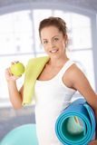 Attractive female having apple after workout Stock Images