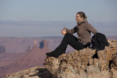 Attractive Female Hiker Sitting On A Rock Stock Images