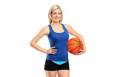 Attractive female holding a basketball Royalty Free Stock Photos