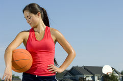 Attractive female holding a basketball Stock Photography