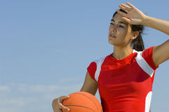 Attractive female holding a basketball Royalty Free Stock Photo