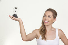 Attractive female holding a bulb and looking at it Royalty Free Stock Photo