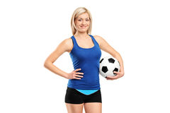 Attractive female holding a football Stock Photo