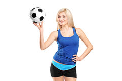 Attractive female holding a football Royalty Free Stock Image