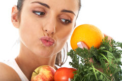 Attractive female holds bunch of fruit and veg Stock Photo