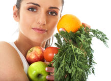 Attractive female holds bunch of fruit and veg Stock Photos