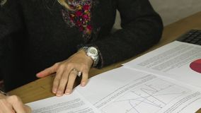 Attractive female italian business executive looking at graphs and statistics stock footage