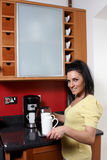 An attractive female in the kitchen Royalty Free Stock Photo