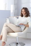 Attractive female with laptop at home Stock Photo