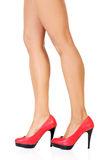 Attractive female legs in red high heels. Royalty Free Stock Photo