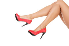 Attractive female legs in red high heels. Isolated on white royalty free stock photography