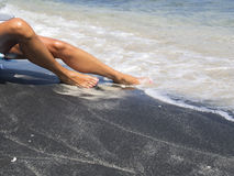 Attractive female legs relaxing on a beautiful  beach Stock Images