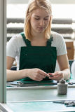 Attractive female line worker Stock Photos